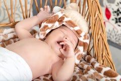 Portrait of Beautiful Boy Lying in Wicker Basket Stock Photography