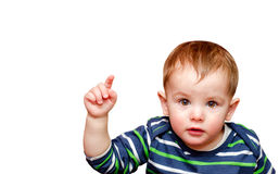 Portrait of beautiful boy pointing finger. Isolated Stock Images