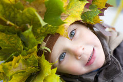 Portrait of beautiful boy in wreath from leaves Stock Images