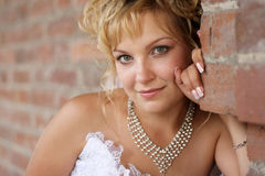 Portrait of a beautiful bride against brick wall Stock Images