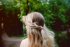 Portrait of a beautiful bride blond girl in pink lace dress ,hair decoration, handmade. Tenderness.Rear view, focus on Stock Image