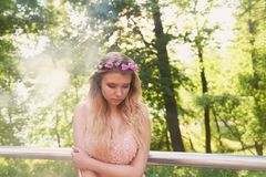 Portrait of a beautiful bride blond girl in pink lace dress ,hair decoration, handmade.Tenderness. The setting sun Stock Image