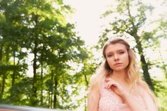 Portrait of a beautiful bride blond girl in pink lace dress ,hair decoration, handmade.Tenderness. The setting sun Royalty Free Stock Images