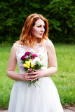 Portrait of a beautiful bride with a bouquet Stock Photos