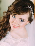 Portrait of a beautiful bride with bright makeup and curly hairstyle Royalty Free Stock Image