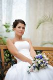 Portrait of beautiful bride with a bunch of flowers Stock Photography