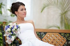 Portrait of beautiful bride with a bunch of flowers Royalty Free Stock Photo