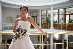 Portrait of beautiful bride with a bunch of flowers Royalty Free Stock Photos