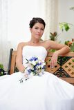 Portrait of beautiful bride with a bunch of flowers Stock Image