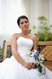 Portrait of beautiful bride with a bunch of flowers Royalty Free Stock Images
