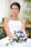 Portrait of beautiful bride with a bunch of flowers Stock Photo