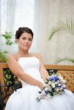 Portrait of beautiful bride with a bunch of flowers Stock Images