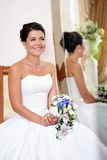 Portrait of beautiful bride with a bunch of flowers Stock Photos