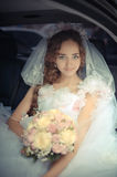 Portrait of beautiful bride in a car Royalty Free Stock Photography