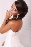 Portrait of beautiful bride with dark hair in elegant dress Stock Image