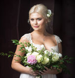 Portrait of beautiful bride in dress. With flowers Stock Image