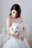 Portrait of beautiful bride. Dress with open back. Wedding decoration Royalty Free Stock Photography