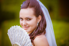 Portrait of the beautiful bride with a fan Stock Image