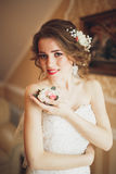 Portrait of beautiful bride with fashion veil and dress at wedding morning.  Stock Image