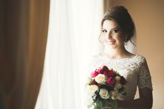 Portrait of beautiful bride with fashion veil at wedding morning Stock Images