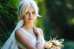 Portrait of beautiful bride. In a forest Stock Photo