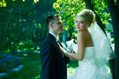 Portrait of a beautiful bride and groom. On a green background Stock Photo