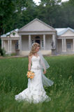 Portrait of Beautiful bride holding bouquet and posing outdoors Royalty Free Stock Photo