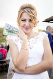 Portrait of beautiful bride holding pack of money Stock Photography