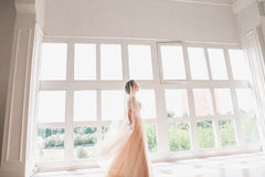 Portrait of beautiful bride indoor. Fashion bride girl in gorgeous wedding dress in studio Royalty Free Stock Photography