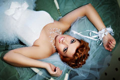 Portrait beautiful bride lying on bed Royalty Free Stock Image