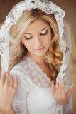 Portrait of beautiful bride with makeup wearing in Classic White Stock Image