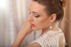 Portrait of beautiful bride model with perfect makeup and hair style in light room in a morning closeup. Portrait of beautiful bride model with perfect makeup Royalty Free Stock Images