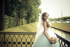 Portrait of beautiful bride in a park Stock Photography