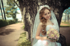 Portrait of beautiful bride in a park Stock Image