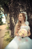Portrait of beautiful bride in a park Royalty Free Stock Photos