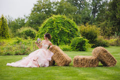 Portrait of a beautiful bride in park stock photo
