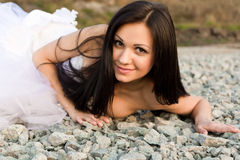 Portrait of a beautiful bride on pebbles Stock Photography