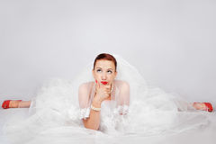 Portrait of beautiful bride in red shoes Stock Photo