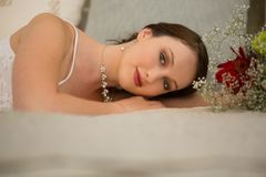 Portrait of beautiful bride relaxing on bed at home Stock Photo