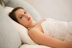 Portrait of beautiful bride relaxing on bed Royalty Free Stock Images