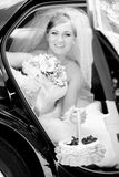 Portrait of beautiful bride sitting on backseat of car Royalty Free Stock Photography