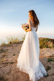 Portrait of beautiful bride standing by the beach Royalty Free Stock Photos
