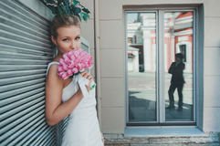 Portrait of beautiful bride with tulips. Wedding make up. Royalty Free Stock Photos
