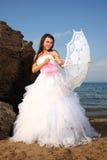 Bride with umbrella Royalty Free Stock Photo