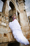Portrait of a beautiful bride under the ruins arch Stock Images