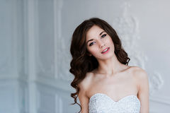Portrait of beautiful bride. Wedding decoration and dress, white background Royalty Free Stock Photo