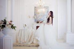 Portrait of beautiful bride. Wedding decoration. Luxurious light interior Royalty Free Stock Photo