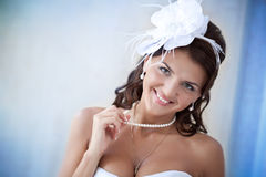 Portrait of beautiful bride in a white dress Stock Images