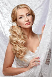 Portrait of a beautiful bride in a white dress. Festive coiffure and makeup. Hairstyle Royalty Free Stock Photo