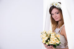 Portrait of beautiful bride in white dress with flowers and copy Stock Images